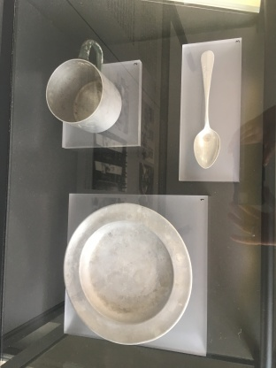 A cup, plate, and spoon used by prisoners of Dachau